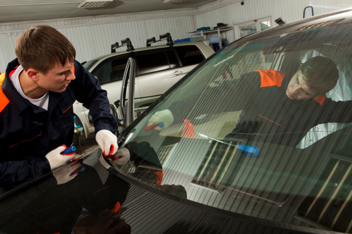 Placing a windshield.